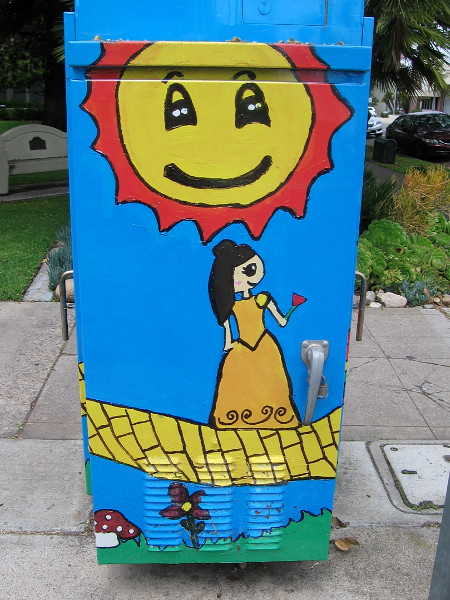 Dorothy walks along the yellow brick road as Art Outside the Box.