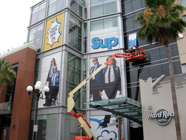 A wrap on the building's south side shows characters from Superstore.