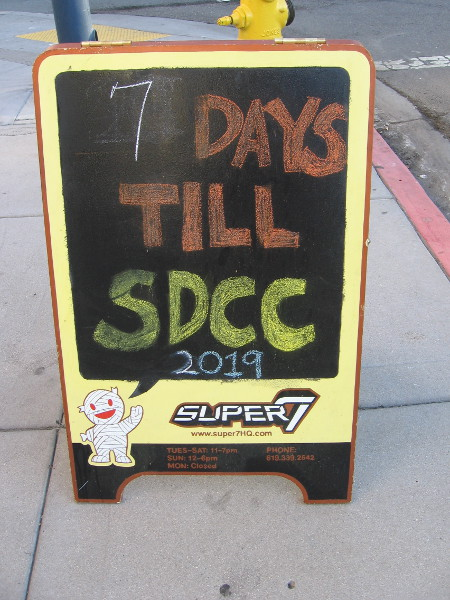 A sign in front of Super7 indicates it's just 7 days till SDCC 2019.