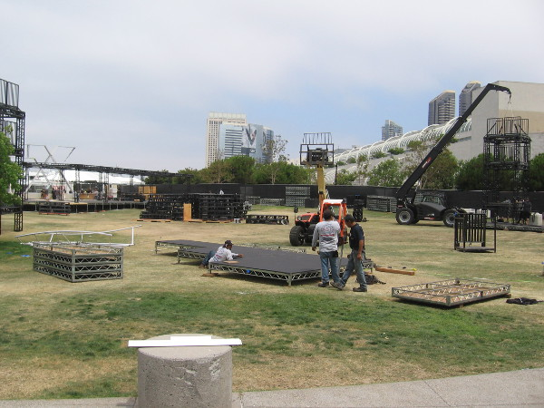 Workers start to set up the FX Fearless Forum in front of the Hilton.