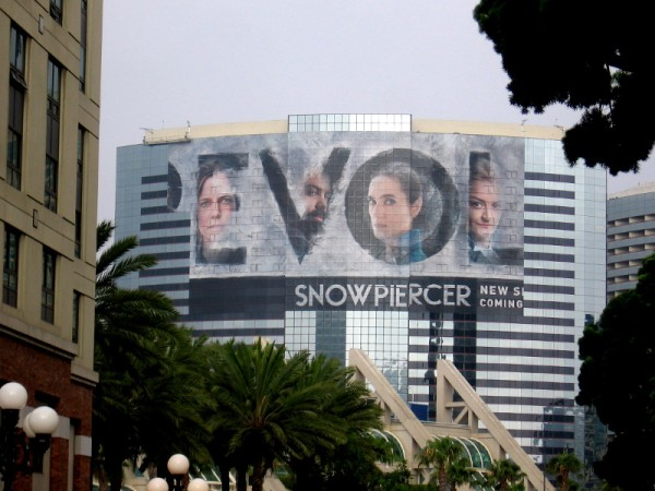 The word REVOLT appears in the Snowpiercer wrap on the Marriott Marquis.