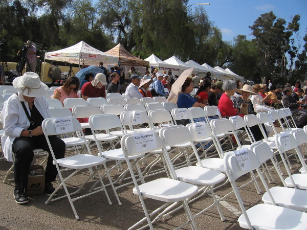 Early arrivals for San Diego's big 250th Anniversary event claim a seat and await some cultural entertainment.