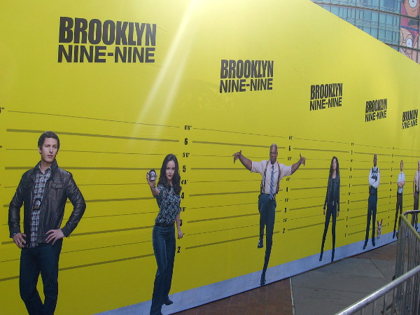 At the Brooklyn Nine-Nine offsite, fans of the show can take a selfie in a lineup with various characters.