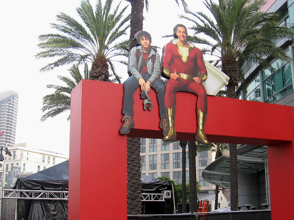 Freddy Freeman and his pal Shazam are perched atop another arch!