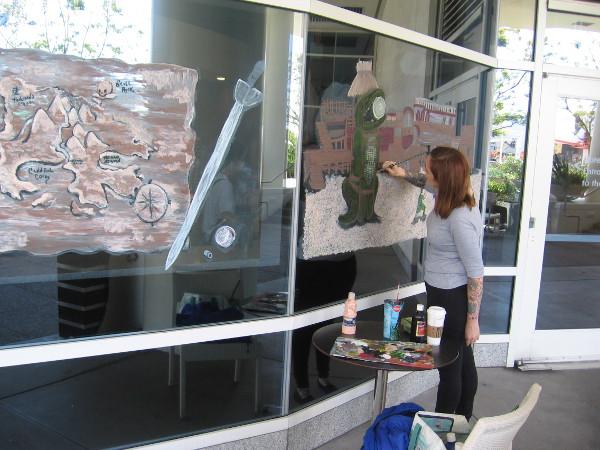More Comic-Con street art on windows of Sweet Things Frozen Yogurt.