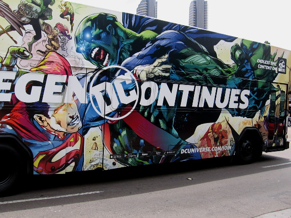 Superman and Martian Manhunter are battling it out on a passing bus!