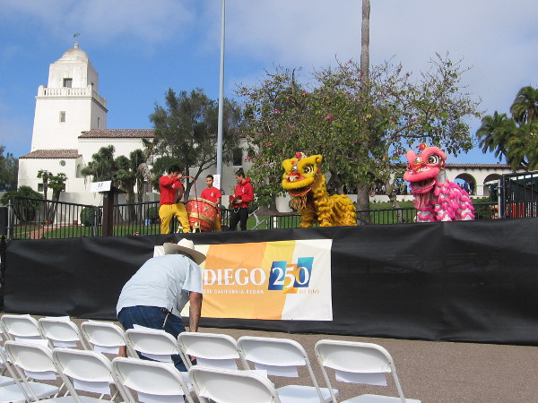 Someone takes a seat in the VIP section as Lion Dancers begin the multicultural entertainment.