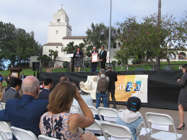 A presentation is made to the San Diego History Center, which operates the Serra Museum and helped to arrange this special ceremony.