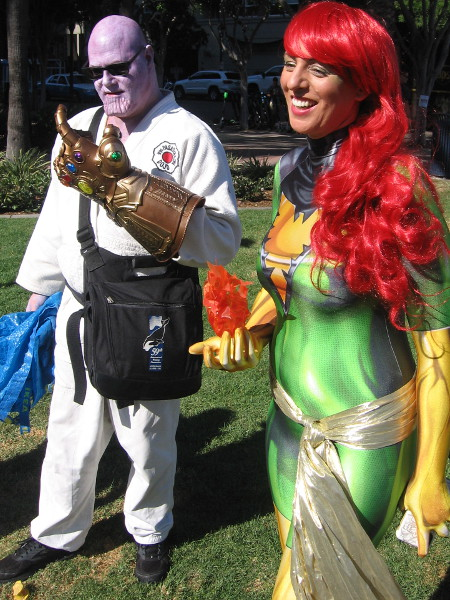 Thanos with Infinity Gauntlet and Jean Grey as Phoenix cosplay.