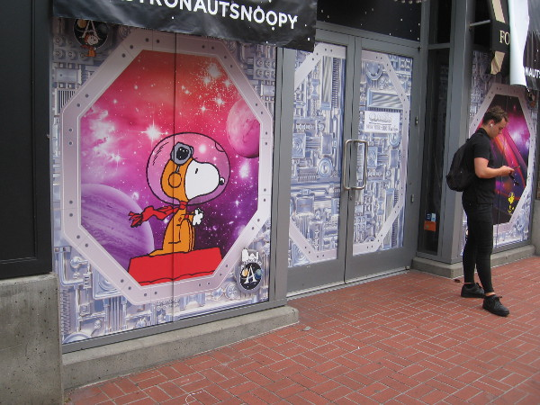 Snoopy rides through space at the Peanuts Pop-Up Shop.