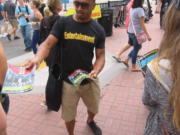 Entertainment Weekly teams were handing out their Comic-Con edition.