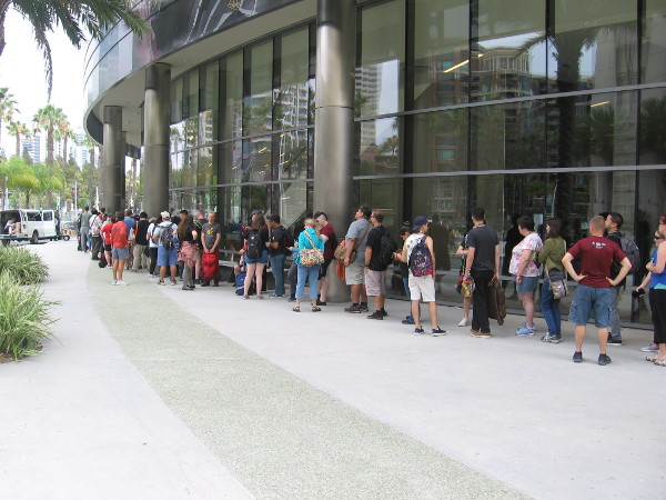A line has formed for Comic-Con pre-ordered merchandise.