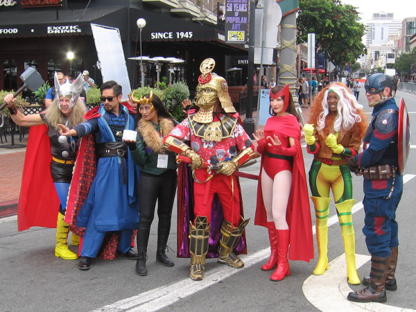 A big lineup of cosplay superheroes in the Gaslamp Quarter during 2019 San Diego Comic-Con!