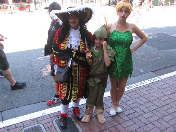 Captain Hook, Peter Pan and Tinker Bell cosplay.