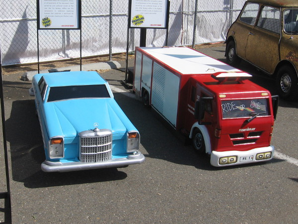 A Mercedes Benz and fire truck coffin. Fantasy coffins are often used by the Ga people of Ghana, Africa to reflect the occupation or status of the deceased.