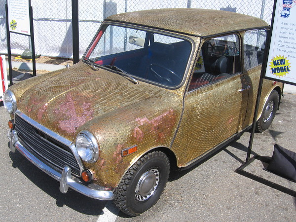 This amazing, functioning Austin Mini is covered with over 10,000 Canadian pennies, each plated with 24 karat gold!
