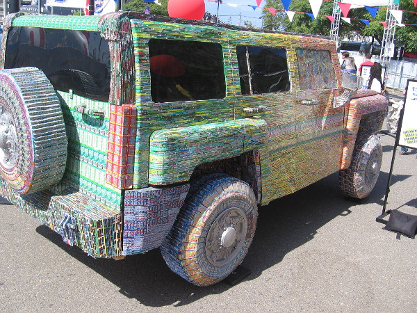 This replica of a Hummer H-3 is covered with over 39,000 lottery tickets!