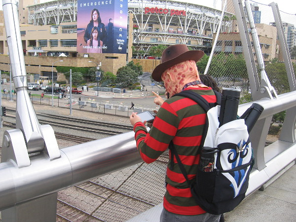 Freddy Krueger checks his phone.