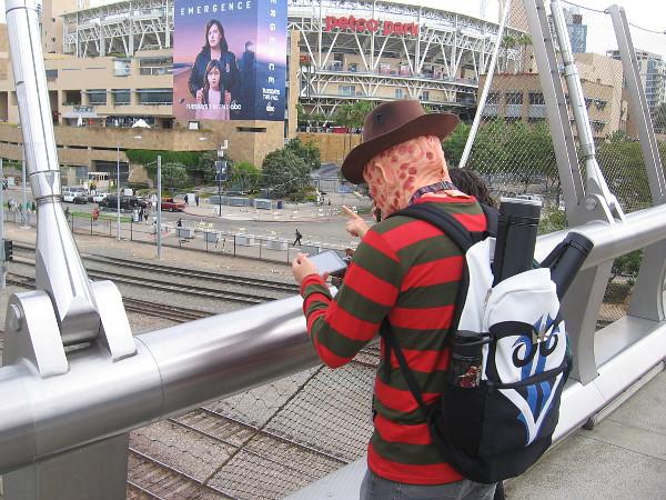 Freddy Krueger checks his phone.