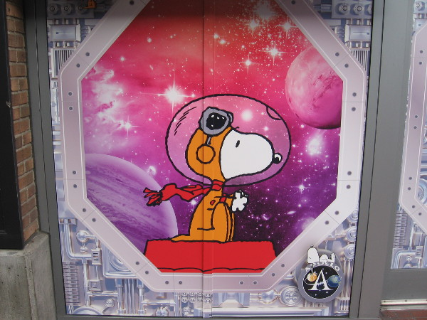 Astronaut Snoopy graphic on the outside of Bubbles Boutique in the Gaslamp Quarter, where the Peanuts Pop-Up Shop is located during Comic-Con.