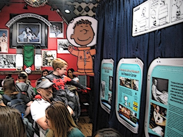 A look inside the Peanuts Pop-Up Shop at two walls of the exhibit. (My photo was blurry so I changed it into a fun cartoon!)