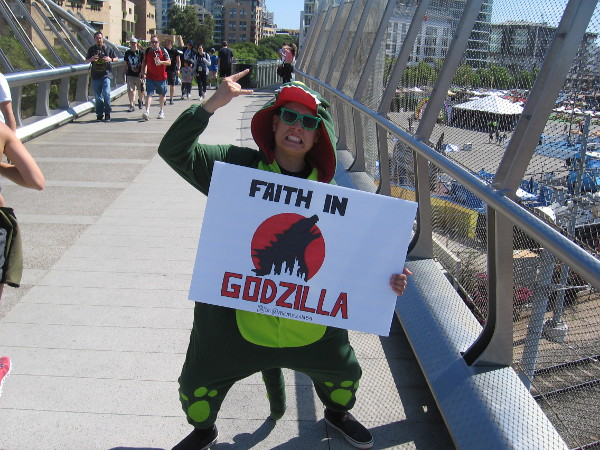 A fanatic demonstrates their unquestioned FAITH IN GODZILLA.