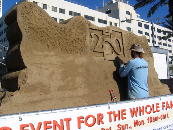 On the other side of the welcoming sand sculpture, a design is being carved that celebrates the 250th anniversary of the city of San Diego!