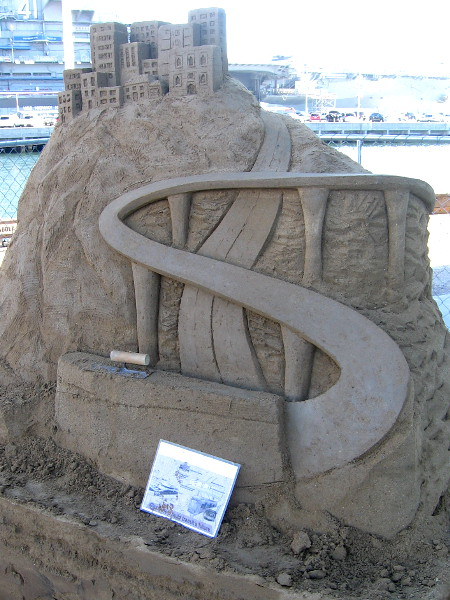 One of the outdoor sand sculptures near the Port Pavilion is sponsored by MTS. It's a work still in progress.