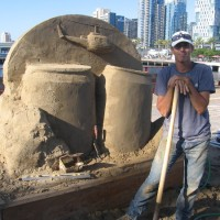 World-class sand masters smile for fun photos!