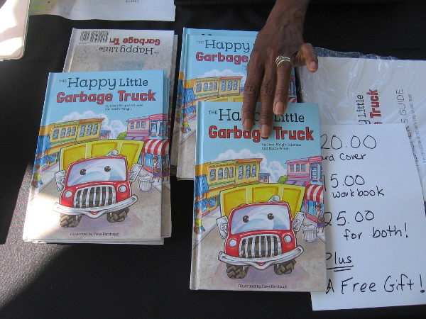 I love the cover of The Happy Little Garbage Truck by author Josan Wright Callender!