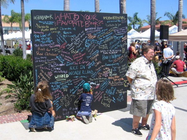 Visitors to the festival could write the title of their favorite book on this big chalkboard.