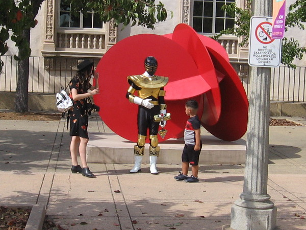 Kid meets Gold Zeo Power Ranger in front of the San Diego Museum of Art!
