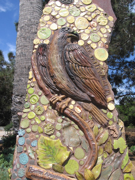 Sculpted tiles form beautiful mosaics that were created by artist Betsy Schulz. This is a red-tailed hawk.