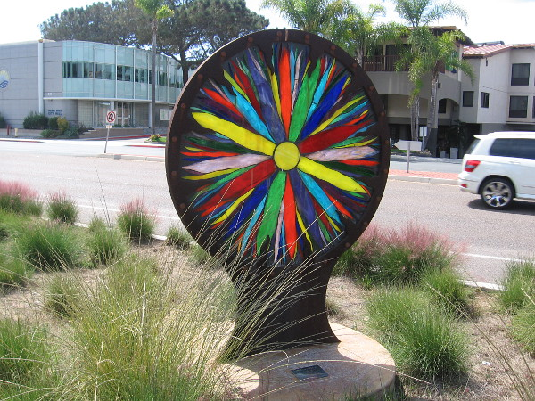I then came upon this colorful stained glass sunburst, standing between the pathway and nearby Highway 101!