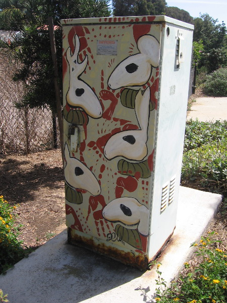 An electrical box with colorfully painted artwork.