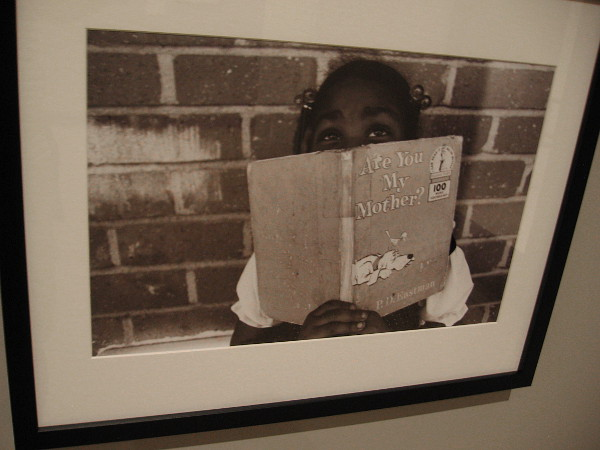 Child Holding Book, Los Angeles, 1983, Guy Crowder.