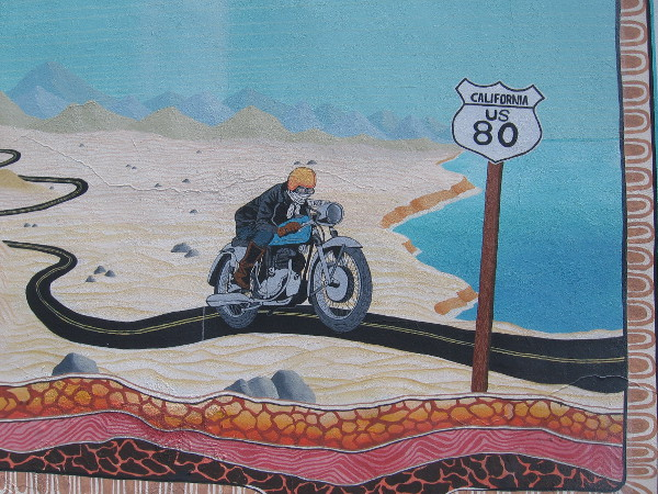 A motorcyclist riding west has reached the Pacific Ocean after crossing desert and mountains.