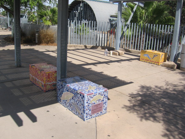 Sea life mosaics decorate concrete benches at the bus stop across from the Solana Beach train station. By artist Michelle Griffoul.
