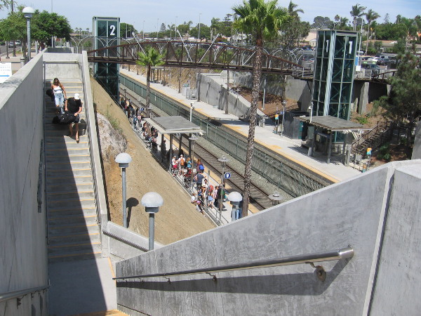 I've come to some steps leading down to the Solana Beach train station platform. Lots of passengers are waiting below.