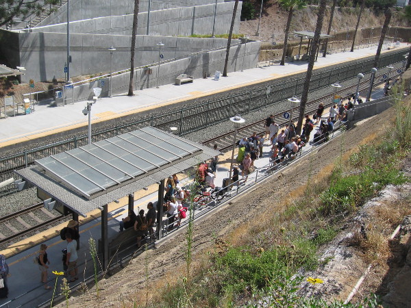 Another photo of people on the train platform below the Coastal Rail Trail in Solana Beach.