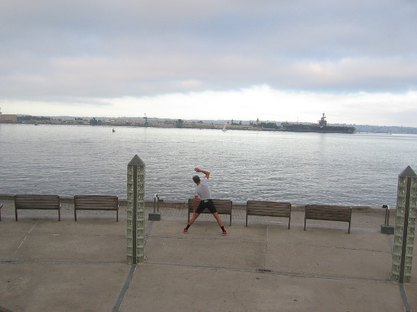 Someone exercises by the water on a beautiful early San Diego morning.