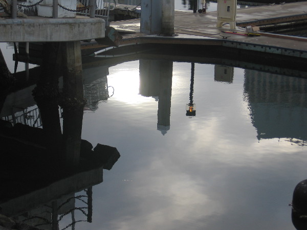 Strange reflections on the smooth water of Tuna Harbor.