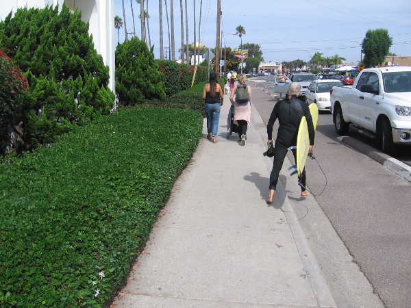 As I walked south, a surfer passed me on the sidewalk going the opposite way.