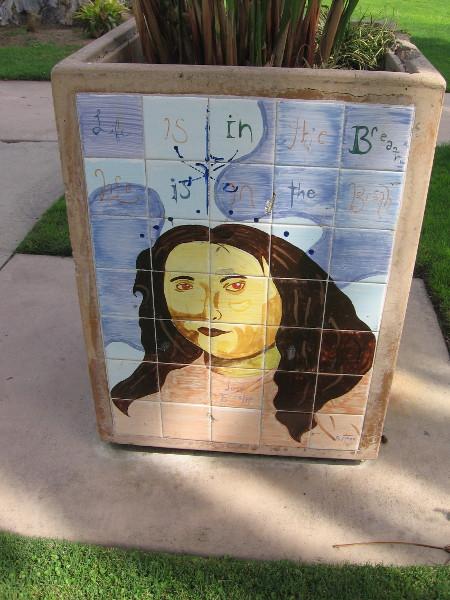 Cool art on a park planter.