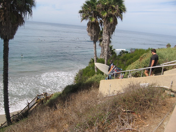 Descending steps to the public beach far below.