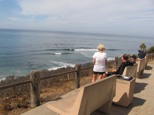 Benches above the bluffs allow people to watch the surfing action at Swami's internationally famous point break.