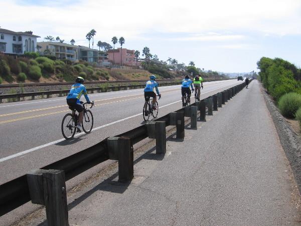 Bicyclists head down South Coast Highway 101, leaving Encinitas.