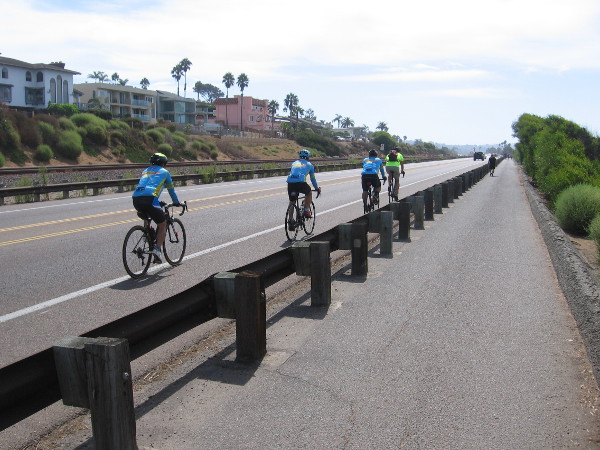 Bicyclists head down South Coast Highway 101, leaving Encinitas.
