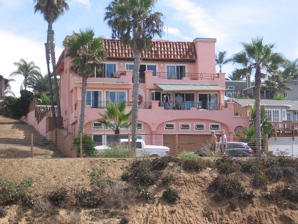 A cool pink residence near the highway with a great view of the ocean.