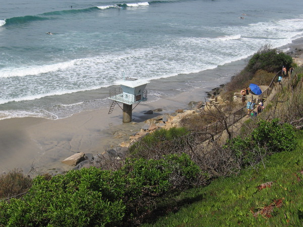 Lifeguard tower 19 near the north end of San Elijo State Beach in Cardiff rises above wet sand.